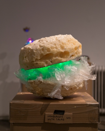Hamburger with Salad, 2017 A Moving Sculpture Size: c. 50 cm x 40cm x 50cm Materials: Polyurethane, play dough, an electric motor, led lights Pictures by Iida-Liina Linnea