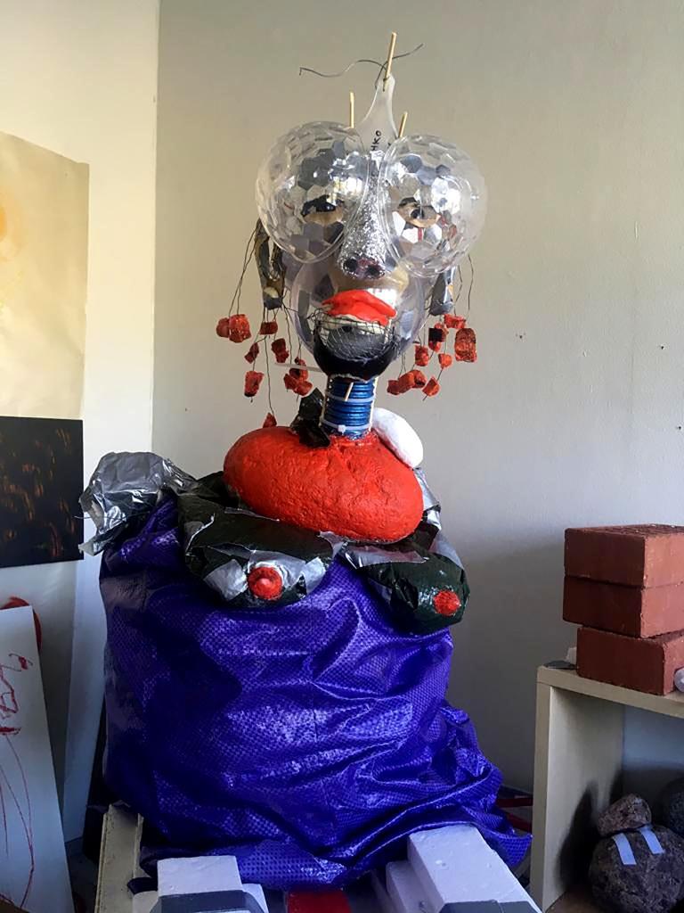 """Sculpture person fron """"It's OK Valley"""" -series. Objet trouvé, stuff, glue, tape, love, and trash materials. 2019. Size: 130 cm x 120cm x 80 cm."""